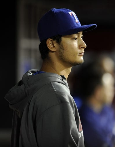 May 2, 2014; Anaheim, CA, USA; Texas Rangers pitcher Yu Darvis walks in the dugout during the game against the Los Angeles Angels during the fourth inning at Angel Stadium of Anaheim. Mandatory Credit: Kelvin Kuo-USA TODAY Sports