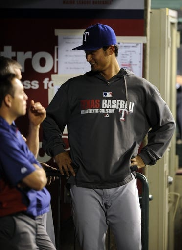 May 2, 2014; Anaheim, CA, USA; Texas Rangers pitcher Yu Darvis poses in the dugout during the game against the Los Angeles Angels during the fourth inning at Angel Stadium of Anaheim. Mandatory Credit: Kelvin Kuo-USA TODAY Sports