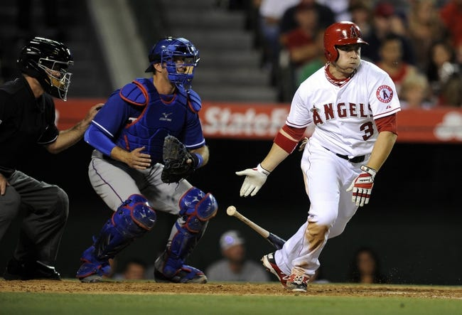 May 2, 2014; Anaheim, CA, USA; Los Angeles Angels left fielder J.B. Shuck (3) follows through on his hit for a single against the Texas Rangers during the fourth inning at Angel Stadium of Anaheim. Mandatory Credit: Kelvin Kuo-USA TODAY Sports