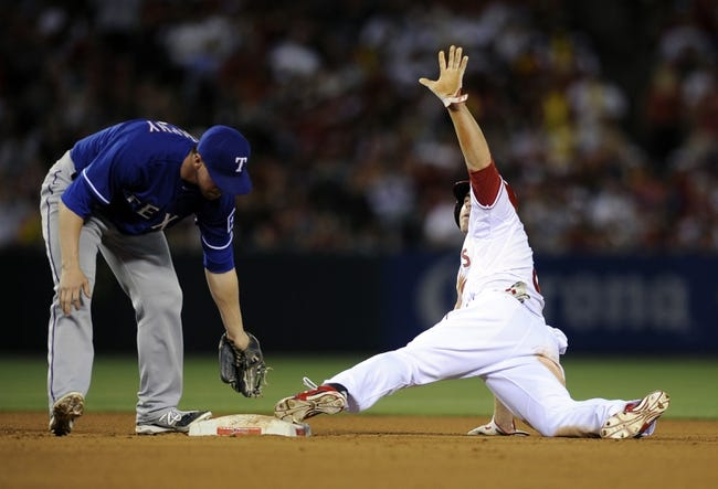 May 2, 2014; Anaheim, CA, USA; Los Angeles Angels left fielder J.B. Shuck (3) celebrates after he steals second base in front of Texas Rangers second baseman Donnie Murphy (16) during the fourth inning at Angel Stadium of Anaheim. Mandatory Credit: Kelvin Kuo-USA TODAY Sports