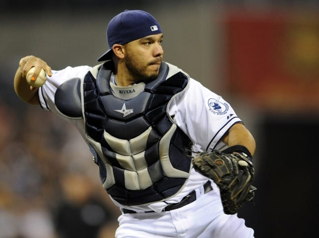 May 2, 2014; San Diego, CA, USA; San Diego Padres catcher Rene Rivera (44) throws the ball to first for an out against the Arizona Diamondbacks at Petco Park. Mandatory Credit: Christopher Hanewinckel-USA TODAY Sports