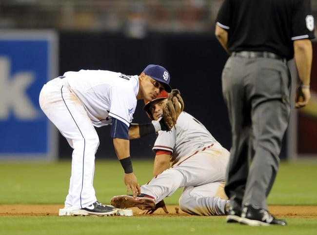 May 2, 2014; San Diego, CA, USA; San Diego Padres shortstop Everth Cabrera (2) tags out Arizona Diamondbacks right fielder Gerardo Parra (8) trying to steal second during the fifth inning at Petco Park. Mandatory Credit: Christopher Hanewinckel-USA TODAY Sports