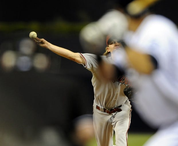 May 2, 2014; San Diego, CA, USA; Arizona Diamondbacks starting pitcher Bronson Arroyo (61) throws during the fifth inning against the San Diego Padres at Petco Park. Mandatory Credit: Christopher Hanewinckel-USA TODAY Sports