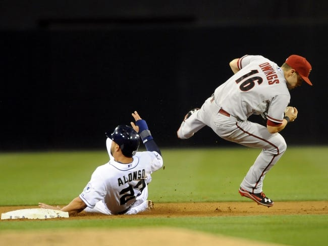 May 2, 2014; San Diego, CA, USA; San Diego Padres first baseman Yonder Alonso (23) breaks up a double play attempt by Arizona Diamondbacks shortstop Chris Owings (16) during the fifth inning at Petco Park. Mandatory Credit: Christopher Hanewinckel-USA TODAY Sports