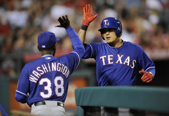May 2, 2014; Anaheim, CA, USA; Texas Rangers left fielder Shin-Soo Choo (right) celebrates with Texas Rangers manager Ron Washington after hitting a one-run home run against the Los Angeles Angels during the sixth inning at Angel Stadium of Anaheim. Mandatory Credit: Kelvin Kuo-USA TODAY Sports