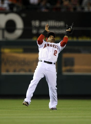 May 2, 2014; Anaheim, CA, USA; Los Angeles Angels shortstop Erick Aybar (2) catches a pop up hit by Texas Rangers shortstop Elvis Andrus (not pictured) during the sixth inning at Angel Stadium of Anaheim. Mandatory Credit: Kelvin Kuo-USA TODAY Sports