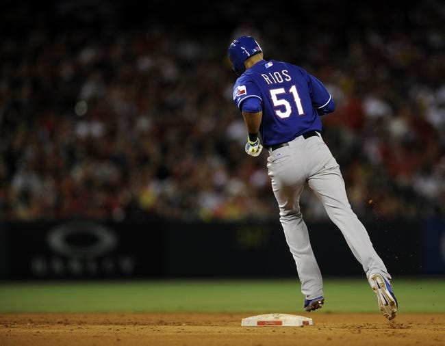 May 2, 2014; Anaheim, CA, USA; Texas Rangers right fielder Alex Rios (51) rounds second base after hitting a two-run home run against the Los Angeles Angels during the sixth inning at Angel Stadium of Anaheim. Mandatory Credit: Kelvin Kuo-USA TODAY Sports