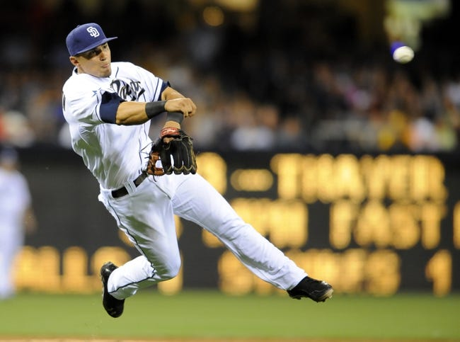 May 2, 2014; San Diego, CA, USA; San Diego Padres third baseman Jace Peterson (3) is unable to make the play on an infield single by Arizona Diamondbacks second baseman Aaron Hill (not pictured) during the ninth inning at Petco Park. Mandatory Credit: Christopher Hanewinckel-USA TODAY Sports