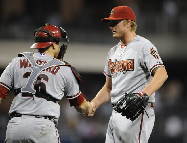 May 2, 2014; San Diego, CA, USA; Arizona Diamondbacks relief pitcher Addison Reed (43) celebrates with catcher Miguel Montero (26) after a win against the San Diego Padres at Petco Park. The Diamondbacks won 2-0. Mandatory Credit: Christopher Hanewinckel-USA TODAY Sports
