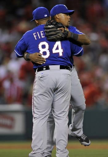 May 2, 2014; Anaheim, CA, USA; Texas Rangers first baseman Prince Fielder (front) and Texas Rangers third baseman Adrian Beltre (back) celebrate after the game against the Los Angeles Angels at Angel Stadium of Anaheim. The Texas Rangers defeated the Los Angeles Angels 5-2. Mandatory Credit: Kelvin Kuo-USA TODAY Sports