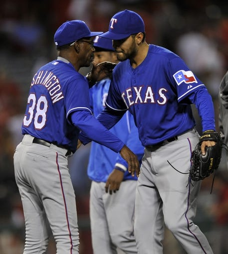 May 2, 2014; Anaheim, CA, USA; Texas Rangers pitcher Joakim Soria (28) celebrates with Texas Rangers manager Ron Washington after the game against the Los Angeles Angels at Angel Stadium of Anaheim. The Texas Rangers defeated the Los Angeles Angels 5-2. Mandatory Credit: Kelvin Kuo-USA TODAY Sports