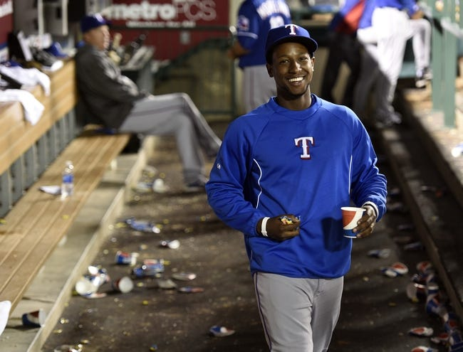 May 2, 2014; Anaheim, CA, USA; Texas Rangers Jurickson Profar grabs a handful of gun during the game against the Los Angeles Angels during the ninth inning at Angel Stadium of Anaheim. The Texas Rangers defeated the Los Angeles Angels 5-2. Mandatory Credit: Kelvin Kuo-USA TODAY Sports
