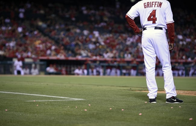 May 2, 2014; Anaheim, CA, USA; Bubble gum surrounds Los Angeles Angels first base coach Alfredo Griffin from gum thrown from the Texas Rangers dugout during the ninth inning at Angel Stadium of Anaheim. The Texas Rangers defeated the Los Angeles Angels 5-2. Mandatory Credit: Kelvin Kuo-USA TODAY Sports