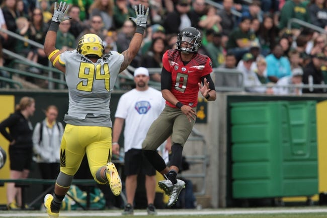 May 3, 2014; Eugene, OR, USA; Oregon Ducks quarterback Marcus Mariota (8) throws the ball at Autzen Stadium. Mandatory Credit: Scott Olmos-USA TODAY Sports