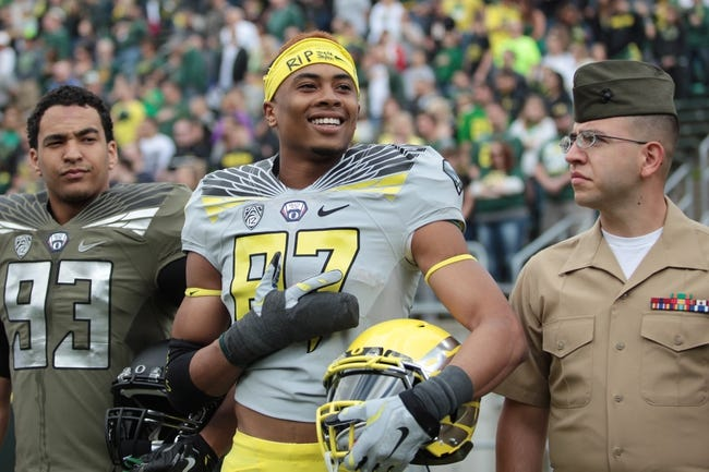 May 3, 2014; Eugene, OR, USA; Oregon Ducks wide receiver Darren Carrington (87) stands with US military personnel before the Spring Game at Autzen Stadium. Mandatory Credit: Scott Olmos-USA TODAY Sports