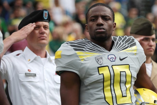 May 3, 2014; Eugene, OR, USA; Oregon Ducks wide Receiver Johnathan Loyd (10) stands with US military personnel before the Spring Game at Autzen Stadium. Mandatory Credit: Scott Olmos-USA TODAY Sports