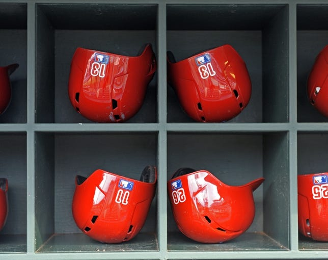 May 3, 2014; Philadelphia, PA, USA; Philadelphia Phillies batting helmets belonging to in the dugout before game against the Washington Nationals at Citizens Bank Park. Mandatory Credit: Eric Hartline-USA TODAY Sports