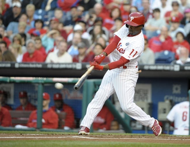 May 3, 2014; Philadelphia, PA, USA; Philadelphia Phillies shortstop Jimmy Rollins (11) hits a single in the first inning against the Washington Nationals at Citizens Bank Park. Mandatory Credit: Eric Hartline-USA TODAY Sports