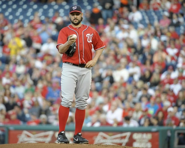 May 3, 2014; Philadelphia, PA, USA; Washington Nationals starting pitcher Tanner Roark (57) checks the baseball during the first inning against the Philadelphia Phillies at Citizens Bank Park. Mandatory Credit: Eric Hartline-USA TODAY Sports