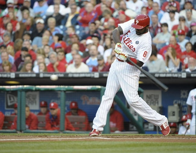 May 3, 2014; Philadelphia, PA, USA; Philadelphia Phillies first baseman Ryan Howard (6) hits a three run home run in the first inning against the Washington Nationals at Citizens Bank Park. Mandatory Credit: Eric Hartline-USA TODAY Sports