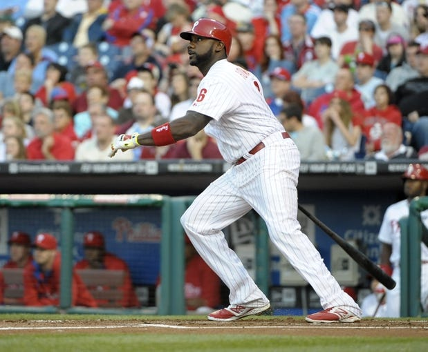 May 3, 2014; Philadelphia, PA, USA; Philadelphia Phillies first baseman Ryan Howard (6) watches his three run home run in the first inning against the Washington Nationals at Citizens Bank Park. Mandatory Credit: Eric Hartline-USA TODAY Sports