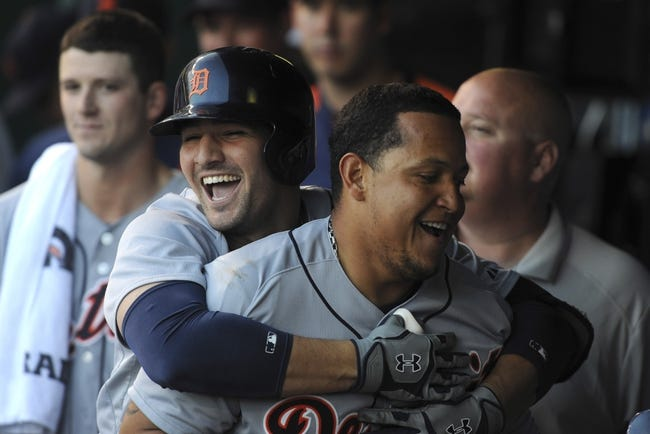 May 3, 2014; Kansas City, MO, USA; Detroit Tigers first baseman Miguel Cabrera (front) is congratulated by third baseman Nick Castellanos (laughing) after scoring against the Kansas City Royals in the fourth inning at Kauffman Stadium. Mandatory Credit: John Rieger-USA TODAY Sports