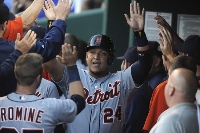 May 3, 2014; Kansas City, MO, USA; Detroit Tigers first baseman Miguel Cabrera (24) is congratulated in the dugout after scoring against the Kansas City Royals in the fourth inning at Kauffman Stadium. Mandatory Credit: John Rieger-USA TODAY Sports