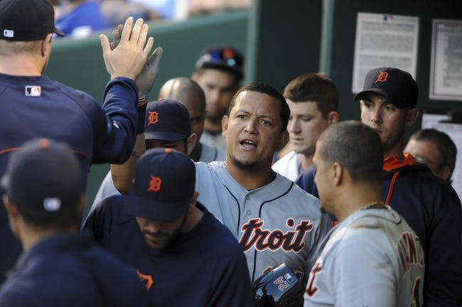 May 3, 2014; Kansas City, MO, USA; Detroit Tigers first baseman Miguel Cabrera (24) is congratulated after scoring on a hit by third baseman Nick Castellanos (9) against the Kansas City Royals in the sixth inning at Kauffman Stadium. Mandatory Credit: John Rieger-USA TODAY Sports