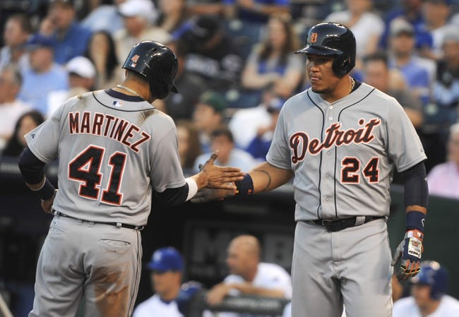 May 3, 2014; Kansas City, MO, USA; Detroit Tigers designated hitter Victor Martinez (41) and first baseman Miguel Cabrera (24) celebrate after scoring on a hit by third baseman Nick Castellanos (not shown) against the Kansas City Royals in the sixth inning at Kauffman Stadium. Mandatory Credit: John Rieger-USA TODAY Sports