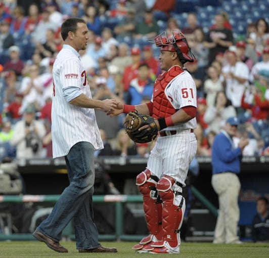 May 3, 2014; Philadelphia, PA, USA; Former Philadelphia Phillies pitcher Brad Lidge is greeted by catcher Carlos Ruiz (51) after throwing out the first pitch before game against the Washington Nationals at Citizens Bank Park. Mandatory Credit: Eric Hartline-USA TODAY Sports