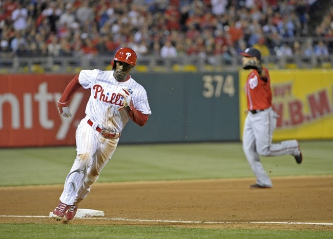 May 3, 2014; Philadelphia, PA, USA; Philadelphia Phillies shortstop Jimmy Rollins (11) rounds third base as he scores a run in the fifth inning against the Washington Nationals at Citizens Bank Park. Mandatory Credit: Eric Hartline-USA TODAY Sports