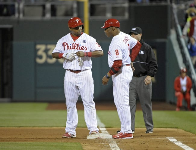 May 3, 2014; Philadelphia, PA, USA; Philadelphia Phillies right fielder Marlon Byrd (3) talk with first base coach Juan Samuel (8) after hitting a two RBI single in the fifth inning against the Washington Nationals at Citizens Bank Park. Mandatory Credit: Eric Hartline-USA TODAY Sports