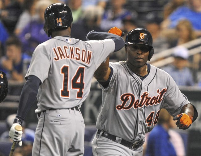 May 3, 2014; Kansas City, MO, USA; Detroit Tigers right fielder Torii Hunter (48) celebrates with center fielder Austin Jackson (14) after hitting home run in the ninth inning against the Kansas City Royals at Kauffman Stadium. Detroit won 9-2. Mandatory Credit: John Rieger-USA TODAY Sports
