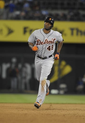 May 3, 2014; Kansas City, MO, USA; Detroit Tigers right fielder Torii Hunter (48) runs the bases after hitting home run in the ninth inning against the Kansas City Royals at Kauffman Stadium. Detroit won 9-2. Mandatory Credit: John Rieger-USA TODAY Sports
