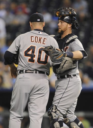 May 3, 2014; Kansas City, MO, USA; Detroit Tigers relief pitcher Phil Coke (40) celebrates with catcher Bryan Holaday (50) after the game against the Kansas City Royals at Kauffman Stadium. Detroit won 9-2. Mandatory Credit: John Rieger-USA TODAY Sports