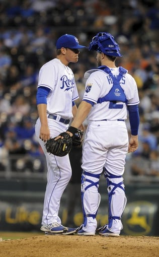 May 3, 2014; Kansas City, MO, USA; Kansas City Royals catcher Brett Hayes (12) talks to relief pitcher Aaron Brooks (62) in the ninth inning against the Detroit Tigers at Kauffman Stadium. Detroit won 9-2. Mandatory Credit: John Rieger-USA TODAY Sports