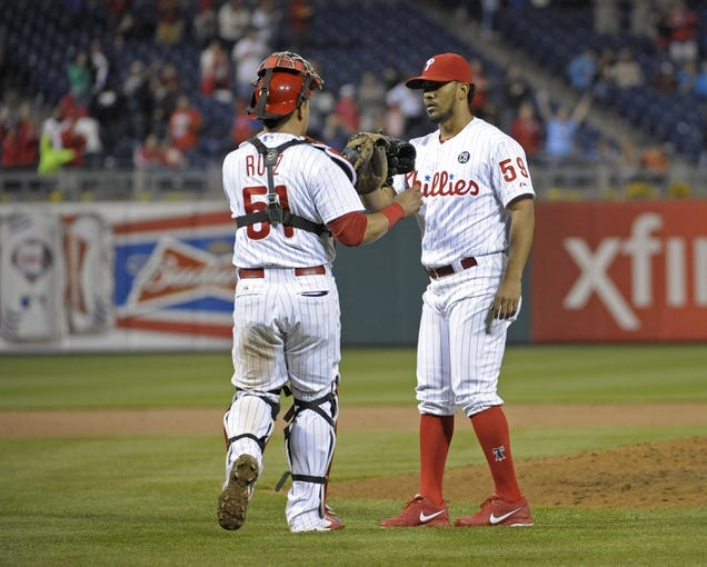 May 3, 2014; Philadelphia, PA, USA; Philadelphia Phillies relief pitcher Antonio Bastardo (59) and catcher Carlos Ruiz (51) celebrate the final out in win against the Washington Nationals at Citizens Bank Park. The Phillies defeated the Nationals, 7-2. Mandatory Credit: Eric Hartline-USA TODAY Sports