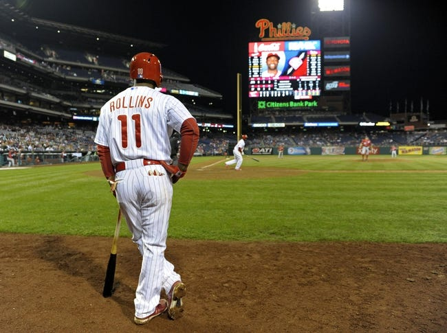 May 3, 2014; Philadelphia, PA, USA; Philadelphia Phillies shortstop Jimmy Rollins (11) waits in the on deck circle as  center fielder Tony Gwynn (19) heads to first base against the Washington Nationals at Citizens Bank Park. The Phillies defeated the Nationals, 7-2. Mandatory Credit: Eric Hartline-USA TODAY Sports