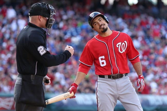 May 4, 2014; Philadelphia, PA, USA; Washington Nationals third baseman Anthony Rendon (6) glances back at umpire Fieldin Culbreth (25) after being called out on strikes to end the 8th inning of a game against the Philadelphia Phillies at Citizens Bank Park.  The Phillies defeated the Nationals 1-0. Mandatory Credit: Bill Streicher-USA TODAY Sports