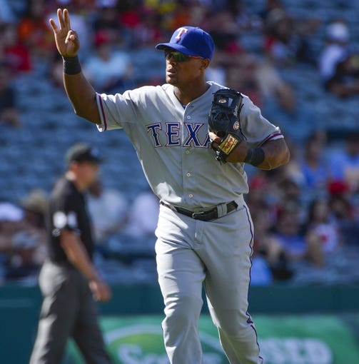 May 4, 2014; Anaheim, CA, USA; Texas Rangers third baseman Adrian Beltre (29) signals strike three and three outs in the 7th inning against the Los Angeles Angels at Angel Stadium of Anaheim. Mandatory Credit: Robert Hanashiro-USA TODAY Sports