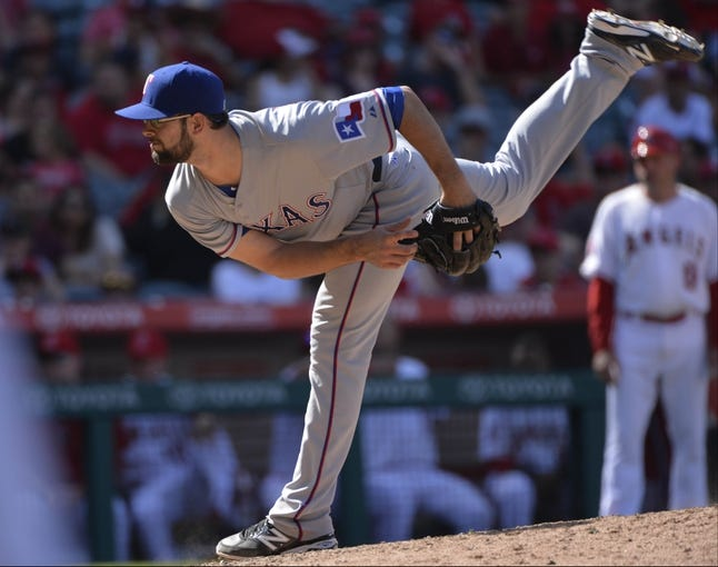 May 4, 2014; Anaheim, CA, USA; Texas Rangers starting pitcher Nick Martinez (22) throws against the Los Angeles Angels at Angel Stadium of Anaheim. The Angels lost 14-3. Mandatory Credit: Robert Hanashiro-USA TODAY Sports