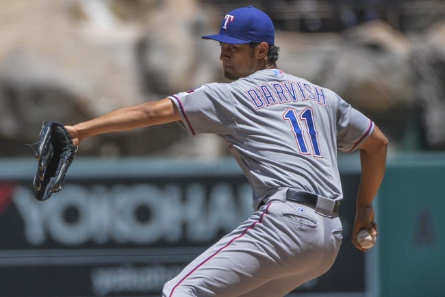 May 4, 2014; Anaheim, CA, USA; Texas Rangers starting pitcher Yu Darvish (11) throws in the first inning against the Los Angeles Angels at Angel Stadium of Anaheim. Mandatory Credit: Robert Hanashiro-USA TODAY Sports