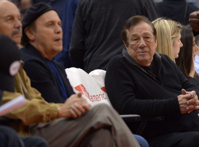 Feb 12, 2014; Los Angeles, CA, USA; Los Angeles Clippers owner Donald Sterling (right) and entertainer and actor Billy Crystal attend the game against the Portland Trail Blazers at Staples Center. The Clippers defeated the Trail Blazers 122-117. Mandatory Credit: Kirby Lee-USA TODAY Sports
