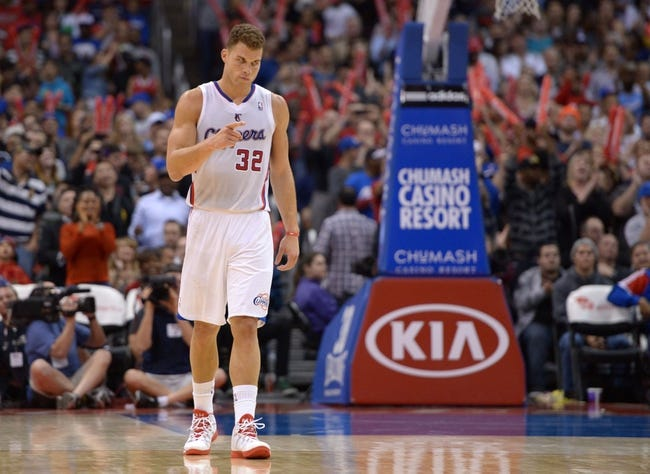 Feb 12, 2014; Los Angeles, CA, USA; Los Angeles Clippers forward Blake Griffin (32) reacts in the fourth quarter against the Portland Trail Blazers at Staples Center. The Clippers defeated the Trail Blazers 122-117. Mandatory Credit: Kirby Lee-USA TODAY Sports