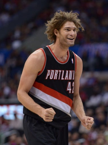 Feb 12, 2014; Los Angeles, CA, USA; Portland Trail Blazers center Robin Lopez (42) reacts during the game against the Los Angeles Clippers at Staples Center. The Clippers defeated the Trail Blazers 122-117. Mandatory Credit: Kirby Lee-USA TODAY Sports