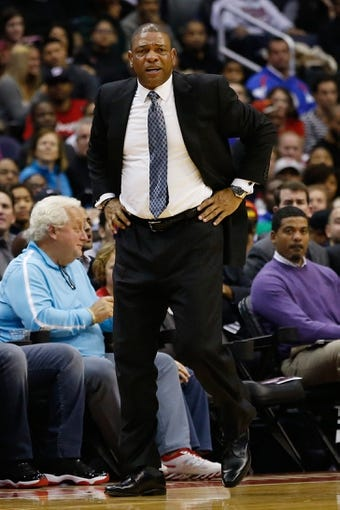 Dec 14, 2013; Washington, DC, USA; Los Angeles Clippers head coach Doc Rivers stands on the sidelines against the Washington Wizards at Verizon Center. Mandatory Credit: Geoff Burke-USA TODAY Sports