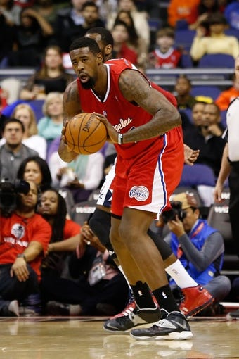 Dec 14, 2013; Washington, DC, USA; Los Angeles Clippers center DeAndre Jordan (6) holds the ball against the Washington Wizards at Verizon Center. Mandatory Credit: Geoff Burke-USA TODAY Sports