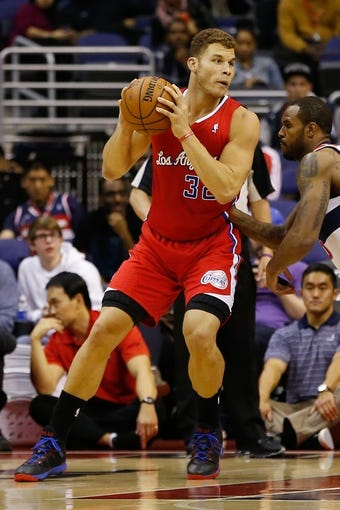Dec 14, 2013; Washington, DC, USA; Los Angeles Clippers power forward Blake Griffin (32) holds the ball against the Washington Wizards at Verizon Center. Mandatory Credit: Geoff Burke-USA TODAY Sports