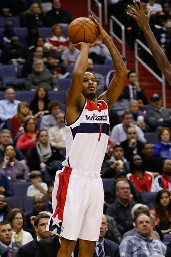 Dec 14, 2013; Washington, DC, USA; Washington Wizards small forward Trevor Ariza (1) shoots the ball against the Los Angeles Clippers at Verizon Center. Mandatory Credit: Geoff Burke-USA TODAY Sports