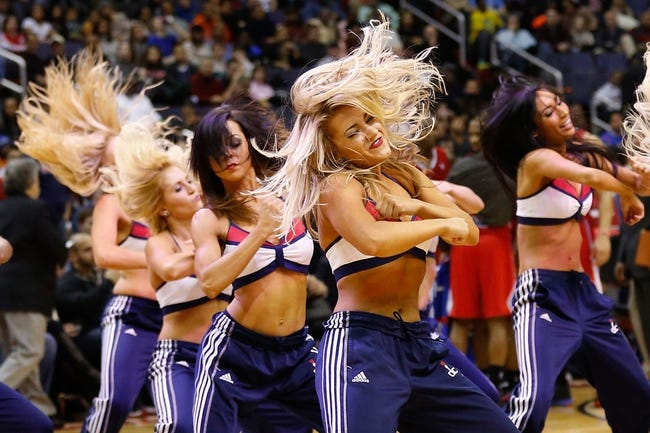 Dec 14, 2013; Washington, DC, USA; Washington Wizards girl dance on the court during a stoppage in play against the Los Angeles Clippers at Verizon Center. Mandatory Credit: Geoff Burke-USA TODAY Sports